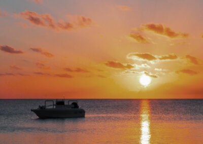 boat on water during golden sunset near fraser island