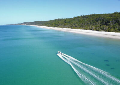 cruising up the coast of fraser island on a gotcha hire boat